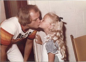 Joe Niekro gives his daughter, Natalie a kiss after a win