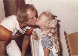 Joe Niekro gives his daughter, Natalie a kiss after a win